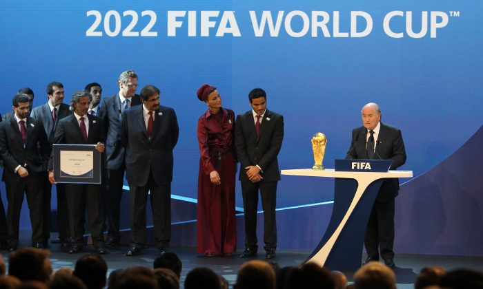 FIFA president Joseph Blatter (R) after Qatar was chosen to host the 2022 World Cup at the FIFA headquarters in Zurich on Dec. 2, 2010. (Karim Jaafar/AFP/Getty Images)