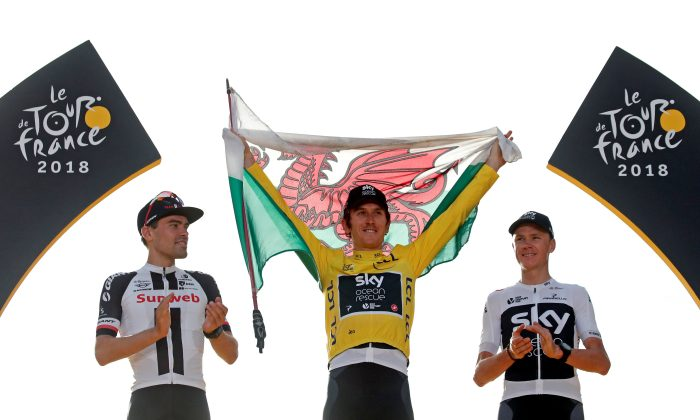 Team Sky rider Geraint Thomas of Britain, wearing the overall leader's yellowjersey, Team Sunweb rider Tom Dumoulin of the Netherlands and Team Sky rider Chris Froome of Britain celebrate on the podium. (Reuters/Benoit Tessier)