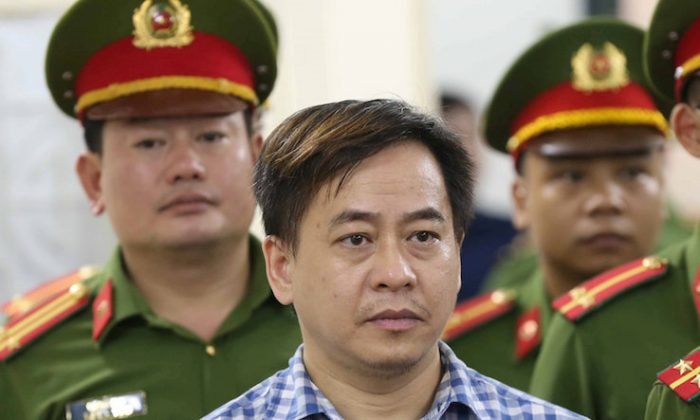 Phan Van Anh Vu (Vu Nhom) listens during the verdict session of his trial at a court in Hanoi, Vietnam July 30, 2018. (VNA/Doan Tan via REUTERS)
