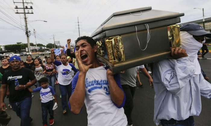 Friends and relatives carry the coffin of the student Gerald Velazquez, shot dead during clashes with riot police, in Managua, Nicaragua, on July 16, 2018. (Inti Ocon/AFP/Getty Images)