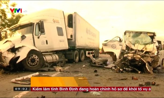 Minibus collided head-on with a large container truck in Central Vietnam, killing  13 people on July 30. (Reuters)
