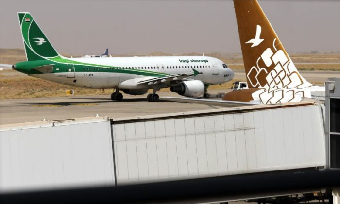 An Iraqi Airways plane is pictured on the tarmac at Erbil Airport, in the capital of Iraq's autonomous northern Kurdish region, on Sept. 28, 2017. (Safin Hamed/AFP/Getty Images)