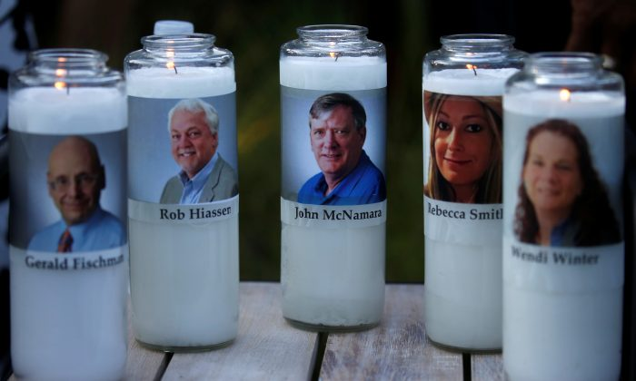 Candles representing the slain Capital Gazette journalists sit on display during a candlelight vigil held near the newspaper's office, the day after a gunman killed five people inside the building in Annapolis, Maryland. (Reuters/Leah Millis)