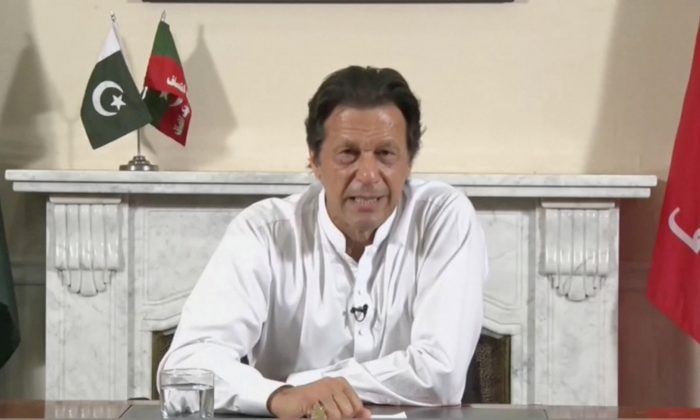 Cricket star-turned-politician Imran Khan, chairman of Pakistan Tehreek-e-Insaf (PTI), gives a speech as he declares victory in the general election in Islamabad, Pakistan, in this still image from a July 26, 2018 handout video by PTI. (PTI handout/via Reuters TV)