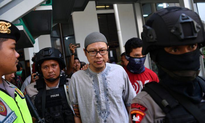 A chief of Jemaah Ansharut Daulah (JAD), the country's largest Islamic State-linked group, arrives for his trial at South Jakarta court in Jakarta, Indonesia, July 31, 2018.  (Antara Foto/Sigid Kurniawan/via Reuters)