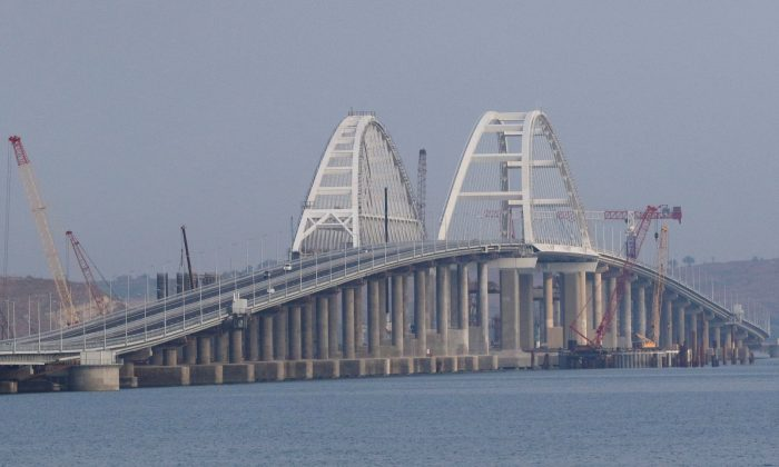 In this file photo, taken on May 16, 2018, cars drive along the Kerch Strait Bridge. (Pavel Rebrov/Reuters/File Photo)