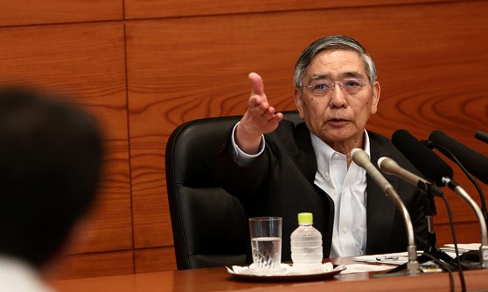 Bank of Japan Governor Haruhiko Kuroda points at a journalist to ask a question during a press conference in Tokyo on July 31, 2018. (Behrouz Mehri/AFP/Getty Images)