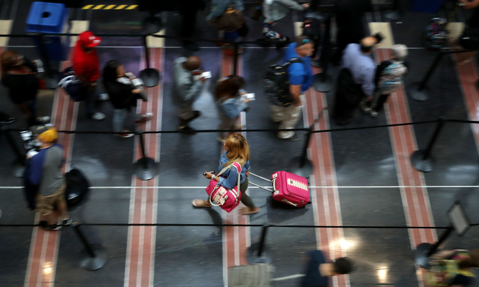 Travelers move through one of the Transportation Security Administration lines at Ronald Reagan National Airport's Terminal B and C September 1, 2017 in Washington, DC. (Chip Somodevilla/Getty Images)