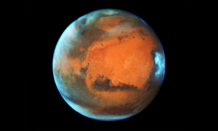 Mars will be closer to Earth than it has in 18 years—and closer than it will be again until 2287. (NASA, ESA, the Hubble Heritage Team (STScI/AURA), J. Bell (ASU), and M. Wolff [Space Science Institute])