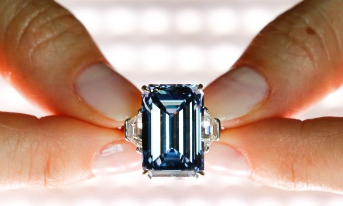 A Christie's employee poses with the 14.62 carats Oppenheimer Blue diamond during a preview in Geneva, Switzerland May 12, 2016.  (Reuters/Denis Balibouse/File Photo)