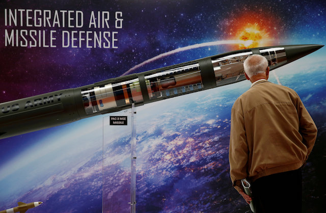 A man looks at a Patriot Advanced Capability (PAC-3) Missile Segment Enhancement (MSE) model by Lockheed Martin at an international military fair in Kielce, Poland Sept. 7, 2017. (REUTERS/Kacper Pempel/File Photo)