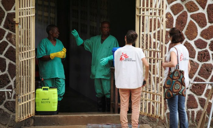 File Photo: Doctors Without borders workers talk to a worker at an isolation facility, prepared to receive suspected Ebola cases, at the Mbandaka General Hospital, in Mbandaka, Democratic Republic of Congo May 20, 2018. (Kenny Katombe/Reuters/File Photo)