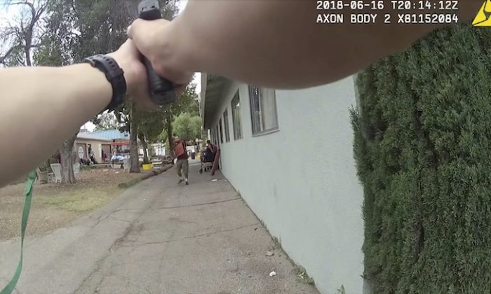 This still image taken from a body camera video released by the Los Angeles Police Department shows a Los Angeles Police Officer confronting an armed suspect in the Van Nuys neighborhood of Los Angeles on June 16, 2018. (Los Angeles Police Department via AP)