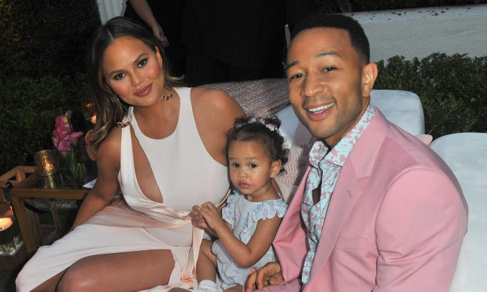 Chrissy Teigen, Luna Simone Stephens and John Legend attend John Legend's launch of his new rose wine brand, LVE, during an intimate Airbnb Concert on June 21, 2018 in Beverly Hills, California. (Photo by Jerod Harris/Getty Images for Airbnb)