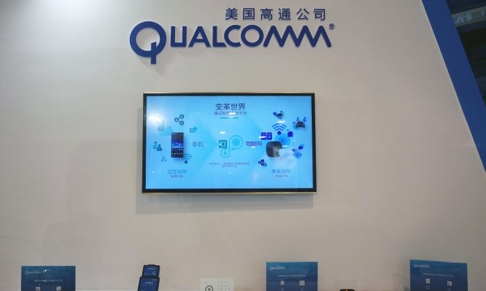 FILE PHOTO: A booth of U.S. chipmaker Qualcomm is pictured at an expo in Beijing, China, September 27, 2017. Picture taken September 27, 2017. (REUTERS/Stringer)