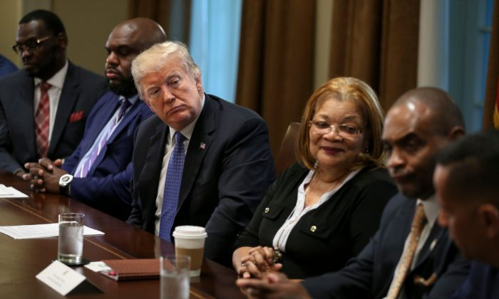 President Donald Trump listens during a meeting with inner-city pastors in the Cabinet Room of the White House in Washington on Aug. 1, 2018. (Oliver Contreras - Pool/Getty Images)