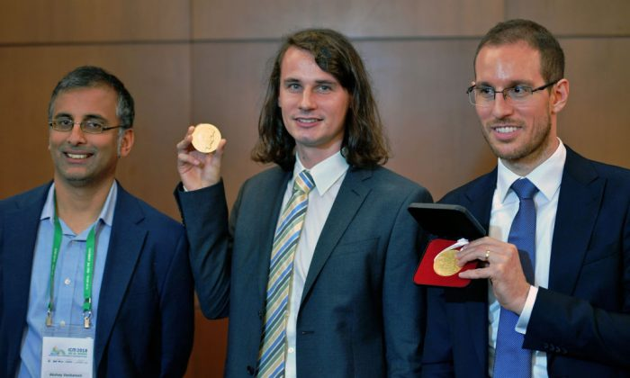 (L-R) Indian-Australian mathematician, Akshay Venkatesh; German mathematician, Peter Scholze; and Italian mathematician, Alessio Figalli, three of the four winners of mathematics' prestigious Fields Medal, often known as the Nobel prize for math, pose at the International Congress of Mathematicians in Rio de Janeiro, Brazil, on Aug. 1, 2018. (Carl de Souza/AFP/Getty Images)