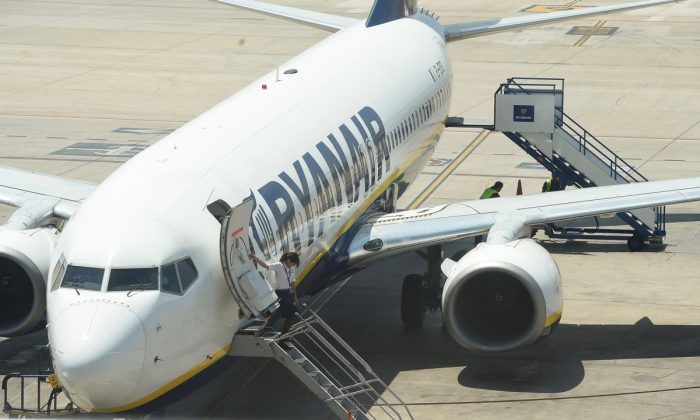A flight attendant waits to greet passengers aboard a Ryanair plane at the airport in Valencia on July 25, 2018. (Jose Jordan/AFP/Getty Images)
