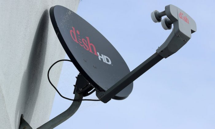 A Dish Network satellite dish is shown on a residential home in Encinitas, California on Nov. 8, 2017. (REUTERS/Mike Blake)