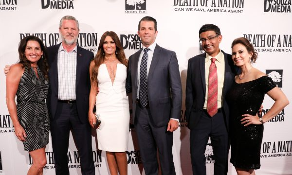 """Jerry Falwell Jr. (2nd L) with his wife Becki, Donald Trump Jr. and girlfriend Kimberly Guilfoyle, and filmmaker Dinesh D'Souza and his wife Debbie Fancherat the premiere of """"Death of a Nation"""" in Washington on Aug. 1, 2018. (Samira Bouaou/The Epoch Times)"""
