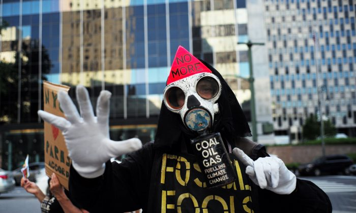 An environmental activist protests President Donald Trump's decision to pull out of the Paris climate accord deal, in New York on June 1, 2017. (JEWEL SAMAD/AFP/Getty Images)