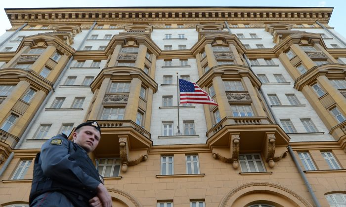 A Russian police officer patrols a street in front of the U.S. Embassy  in Moscow, the headquarters of U.S. Agency for International Development (USAID) Russia's mission, on Sept. 20, 2012. (Kirill Kudryavtsev/AFP/ Getty Images)