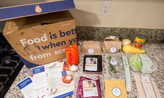 "Items from a ""family-plan"" Blue Apron box are displayed on a kitchen counter on June 28, 2017 in Boston, Massachusetts. (Scott Eisen/Getty Images)"