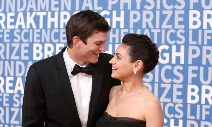 Actors Ashton Kutcher (L) and Mila Kunis attend the 2018 Breakthrough Prize at NASA Ames Research Center on December 3, 2017 in Mountain View, California. (Jesse Grant/Getty Images)