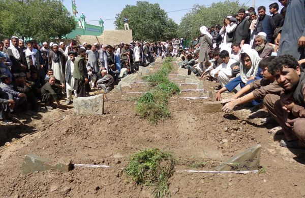 Afghans take part in a burial ceremony for the victims of a suicide bombing attack that took place in a Shi'ite mosque in Gardez, Paktia province, Afghanistan August 4, 2018. (REUTERS/Stringer)