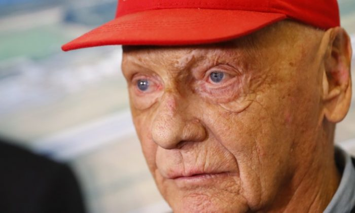 Niki Lauda talks to the media at the airport in Duesseldorf, Germany, March 20, 2018. (REUTERS/Leonhard Foeger)