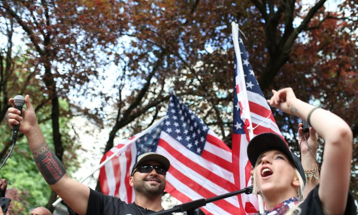 Joey Gibson, left, leader of Patriot Prayer, heads the group's rally in Portland, Oregon on this June 30, 2018. Portland is bracing for what could be another round of violent clashes Saturday, Aug. 4, 2018, between a right-wing group holding a rally here and self-described anti-fascist counter-protesters who have pledged to keep Patriot Prayer and other affiliated groups out of this ultra-liberal city. (Mark Graves/The Oregonian via AP, file)