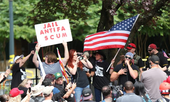 The Patriot Prayer group holds a rally and march in Portland, Ore., on June 30, 2018. (Mark Graves/The Oregonian via AP)