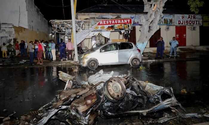 A car is seen parked in front of a restaurant after a car bomb attack at the Maka al Mukaram street in Mogadishu, Somalia on Aug. 5, 2018. (REUTERS/Feisal Omar)