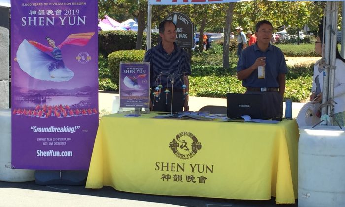 Sales representatives at the Shen Yun ticket booth during the Fremont Festival of the Arts on August 5, 2018 (EETSF).