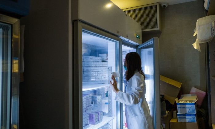 A nurse looks for vaccines at a private clinic that performs vaccinations in Hong Kong on July 24, 2018. (Anthony Wallace/AFP/Getty Images)