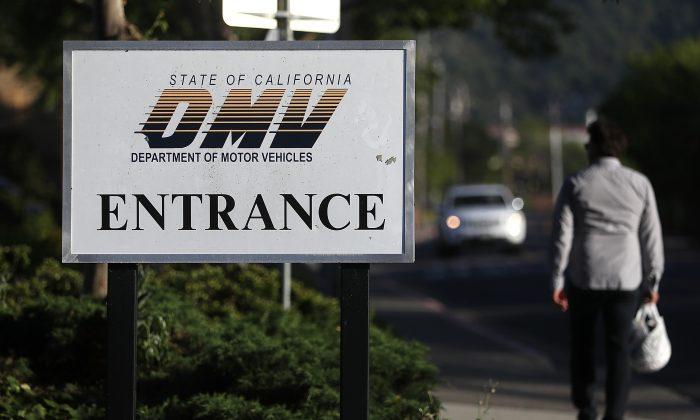 A sign is posted in front of a California Department of Motor Vehicles (DMV) office in Corte Madera, Calif. on May 9, 2017. (Justin Sullivan/Getty Images)