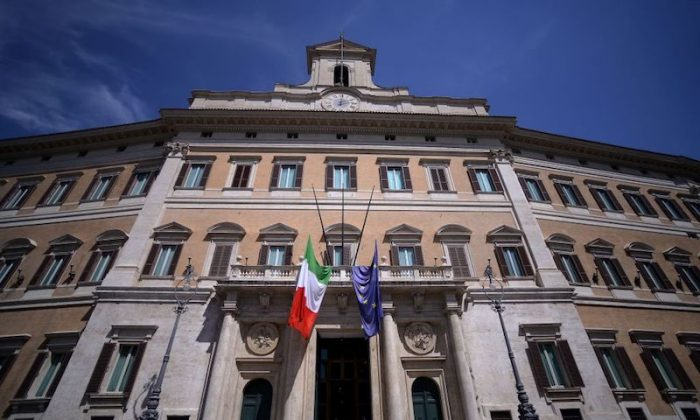 This photo taken on August 18, 2017 shows the Italian and European Union flags at half mast on the facade of the Italian parliament in Piazza Montecitorio in Rome    (FILIPPO MONTEFORTE/AFP/Getty Images)