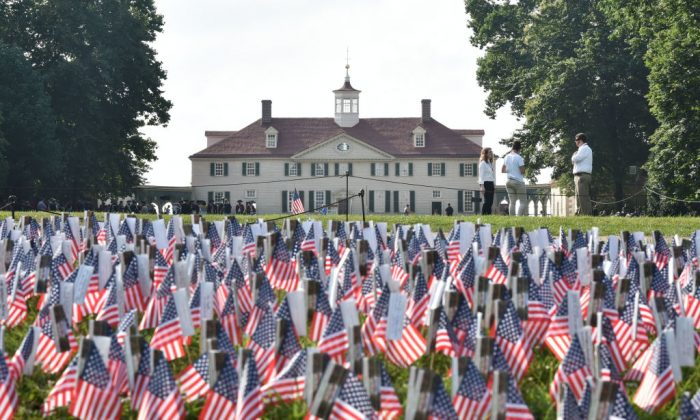 A field of US flags are seen in front of George Washington's Mount Vernon estate during Independence Day celebrations in Mount Vernon, Virginia, on July 4, 2018. (Mandel Ngan/AFP/Getty Images)