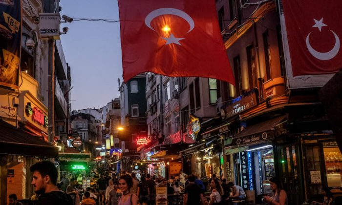 People walk through a street full of restaurants and bars on July 12, 2018 in Istanbul Turkey. (Chris McGrath/Getty Images)