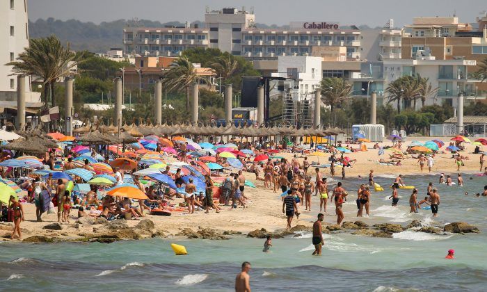 People sunbathe on the beach in Palma de Mallorca, Spain, on Aug. 2. (REUTERS/Enrique Calvo)