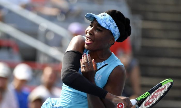 Aug 6, 2018; Montreal, Quebec, Canada; Venus Williams of the United States hits a shot against Caroline Dolehide of the United States (not pictured) in the Rogers Cup tennis tournament. (Eric Bolte—USA TODAY Sports)