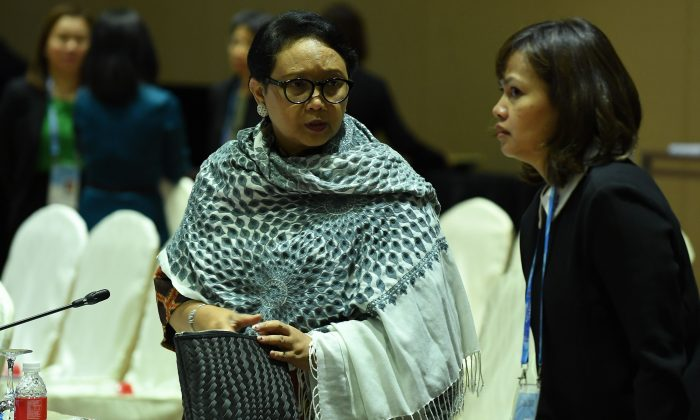Indonesia's foreign minister Retno Marsudi (L) attends the Association of Southeast Asian Nations Ministerial Meeting in Singapore on Aug. 2, 2018. (Mohd Rasfan/AFP/Getty Images)