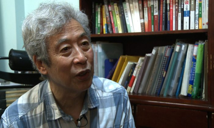 This screen grab taken from AFP video footage shows former professor Sun Wenguang talking in his home in Jinan City, Shandong Province, China, on August 28, 2013.(Tania Lee/AFP/Getty Images)