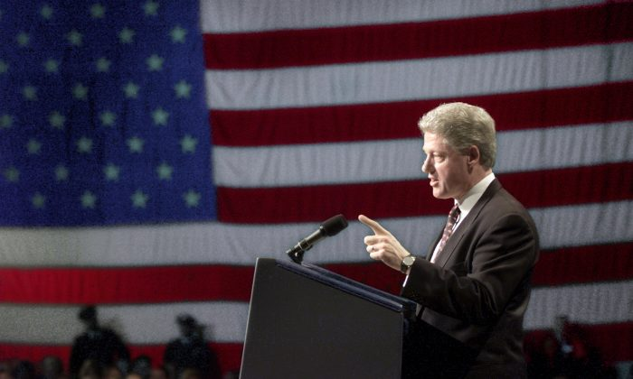 Former President Bill Clinton delivers his speech at the the New Hampshire State Democratic Party 100 Club fund raising dinner late 18 February in Manchester, New Hampshire. (PAUL J. RICHARDS/AFP/Getty Images)