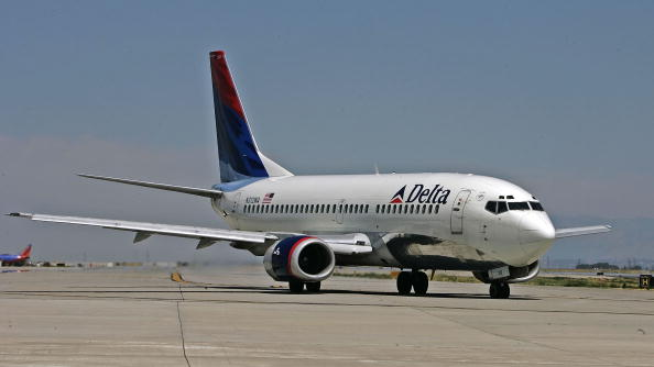 A Delta Airlines jet taxies for take-off at the Salt Lake International Airport Aug. 12, 2005 in Salt Lake City, Utah. (George Frey/Getty Images)