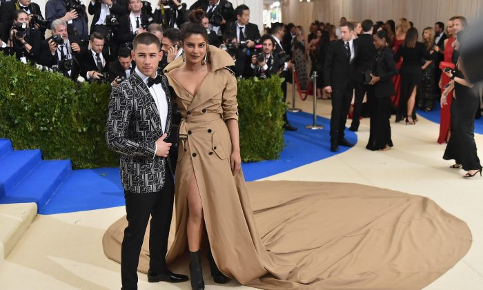 "Nick Jonas (L) and Priyanka Chopra attend the ""Rei Kawakubo/Comme des Garcons: Art Of The In-Between"" Costume Institute Gala at Metropolitan Museum of Art on May 1, 2017 in New York City.  (Photo by Mike Coppola/Getty Images for People.com)"