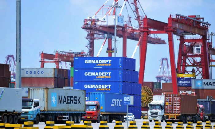 Containers are transferred at a port in Qingdao City, Shandong Province, China on July 6, 2018 (AFP/Getty Images)