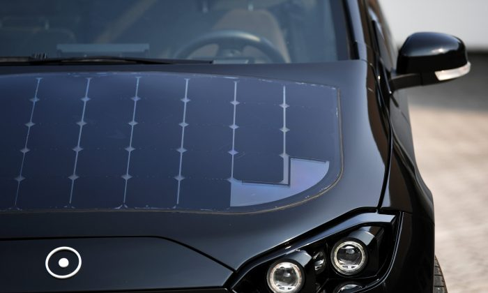 """Solar cell panels are seen on the hood of German solar car company Sono Motors' prototype car """"Sion"""" in Munich, Germany, August 1, 2018. (Reuters/Andreas Gebert)"""