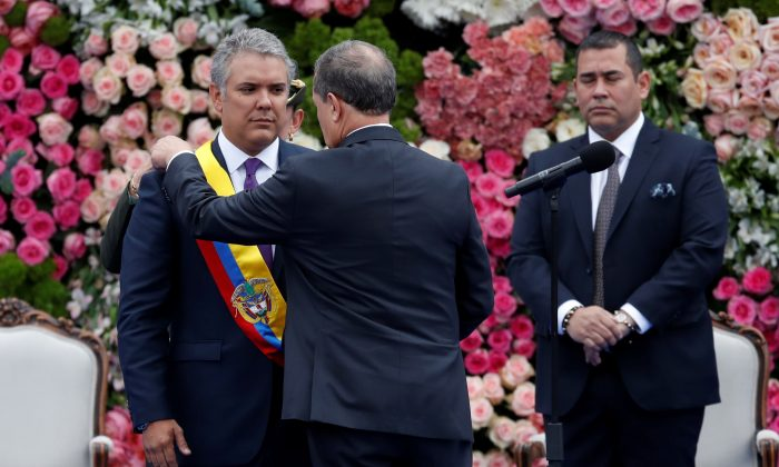 Colombia's President-elect Ivan Duque is sworn in during a ceremony in Plaza Bolivar in Bogota, on Aug. 7, 2018. (Reuters/Carlos Garcia Rawlins)