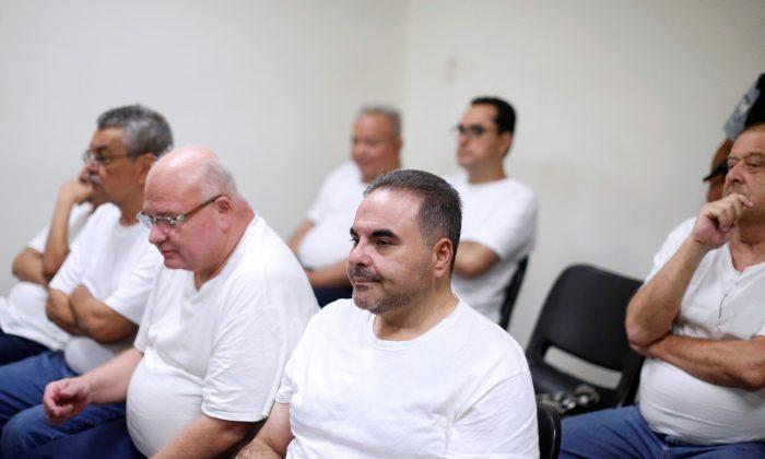 El Salvador's former President Elias Antonio Saca waits at his hearing on corruption charges in San Salvador, El Salvador, August 7, 2018. (Reuters/Jose Cabezas)